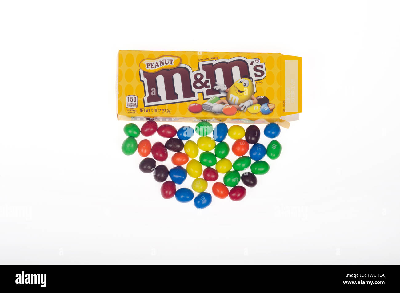 Peanut M&M's candy multi-color snacks with milk chocolate, candy coating & roasted peanuts & box package by Mars, Inc. on white - Stock Image