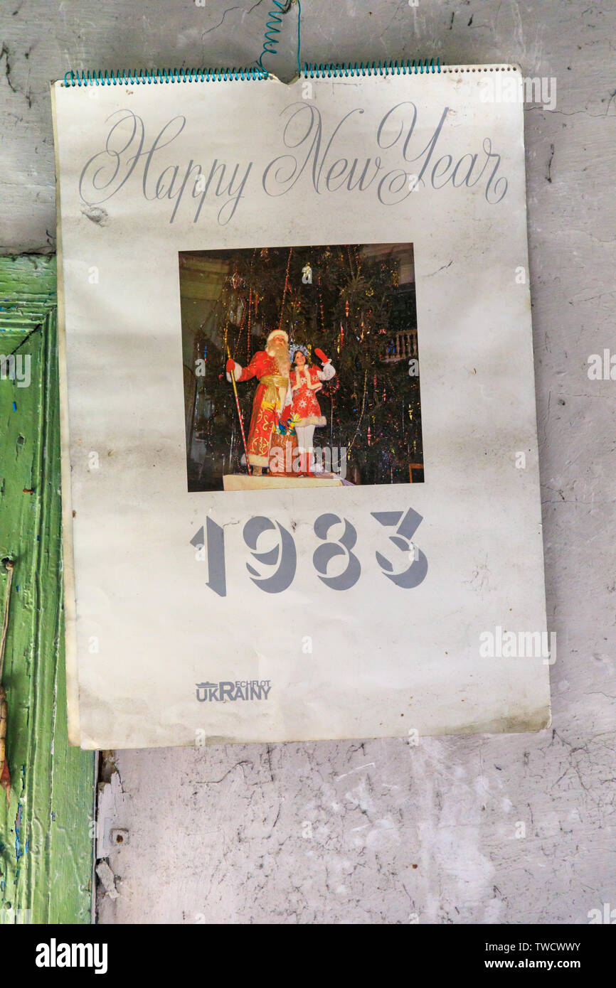 Eastern Europe, Ukraine, Pripyat, Chernobyl. Abandoned home interior. Calendar from 1983 on the wall. April 09, 2018. - Stock Image