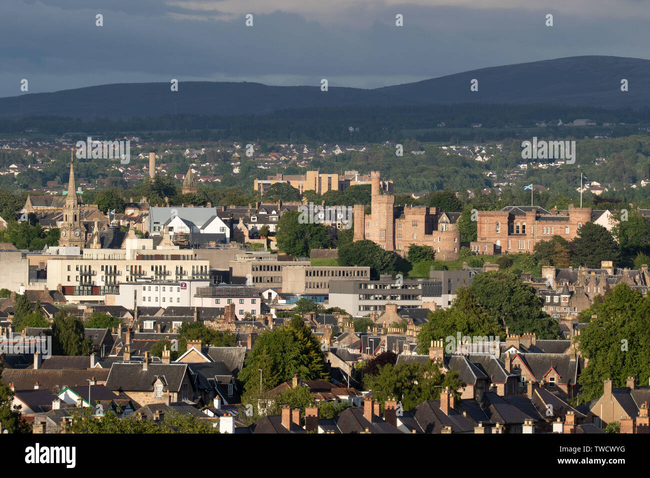 Inverness, UK, 19 June 2019. Inverness Castle at the right of the picture with Raigmore Hospital in the background at the upper centre of the picture. Credit: Andrew Smith - Stock Image