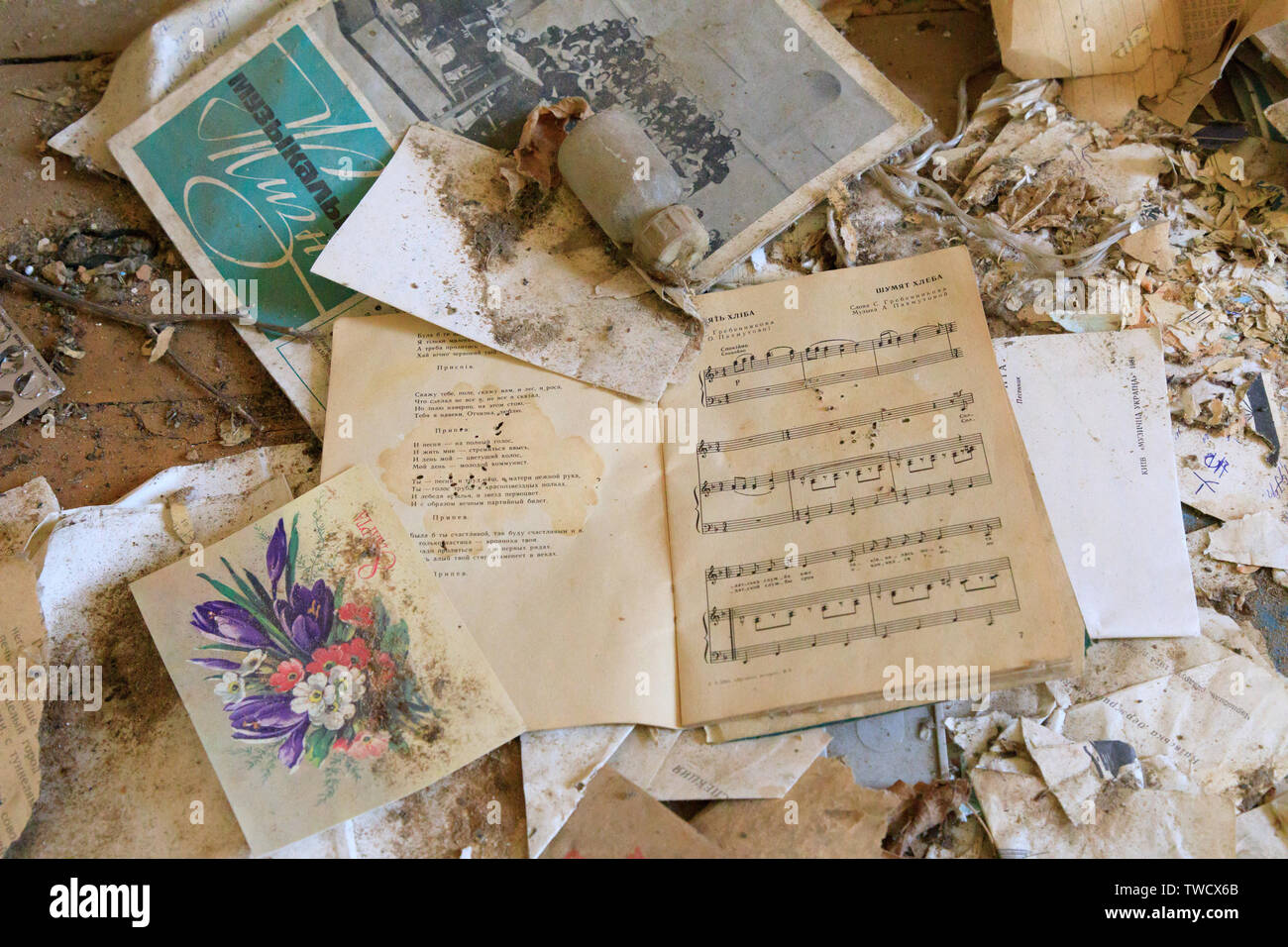Eastern Europe, Ukraine, Pripyat, Chernobyl.  Music book and greeting card on floor. April 09, 2018. - Stock Image