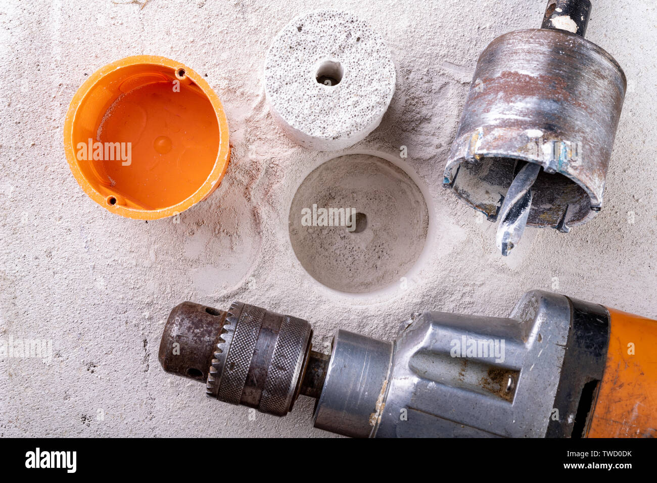 Drill for drilling large holes in the wall. Device for making holes for electrical sockets. Place - workshop. Stock Photo