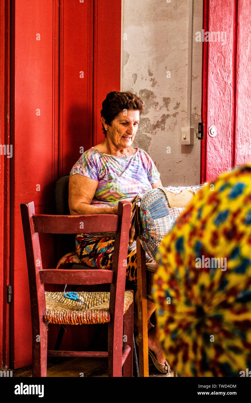 Artisan woman doing bobbin lace work in Sambaqui, at Santo Antonio de Lisboa district. Florianopolis, Santa Catarina, Brazil. Stock Photo