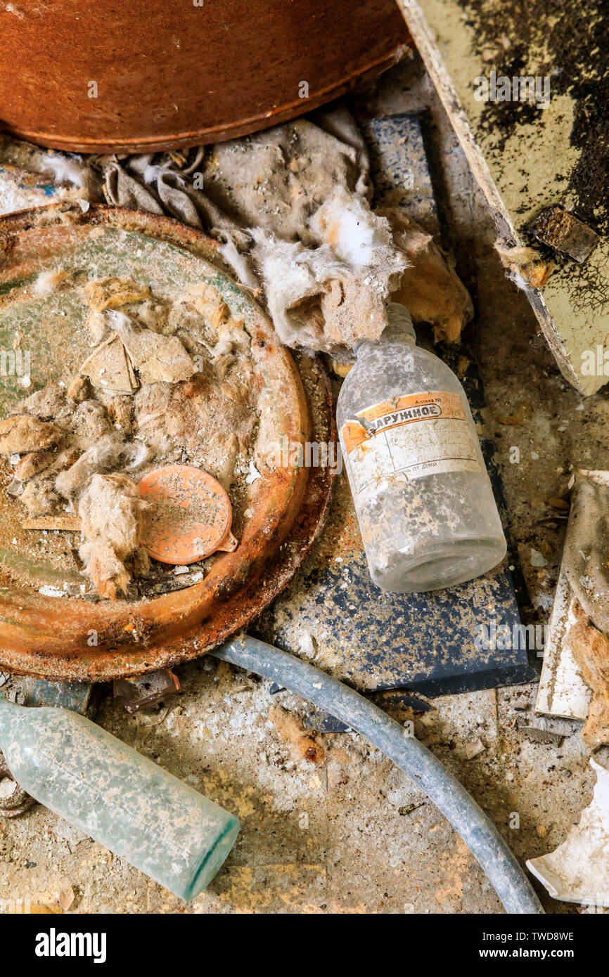 Eastern Europe, Ukraine, Pripyat, Chernobyl. The Hospital MsCh-126 (medical-sanitary unit). Empty bottles and remains of something that might once hav Stock Photo