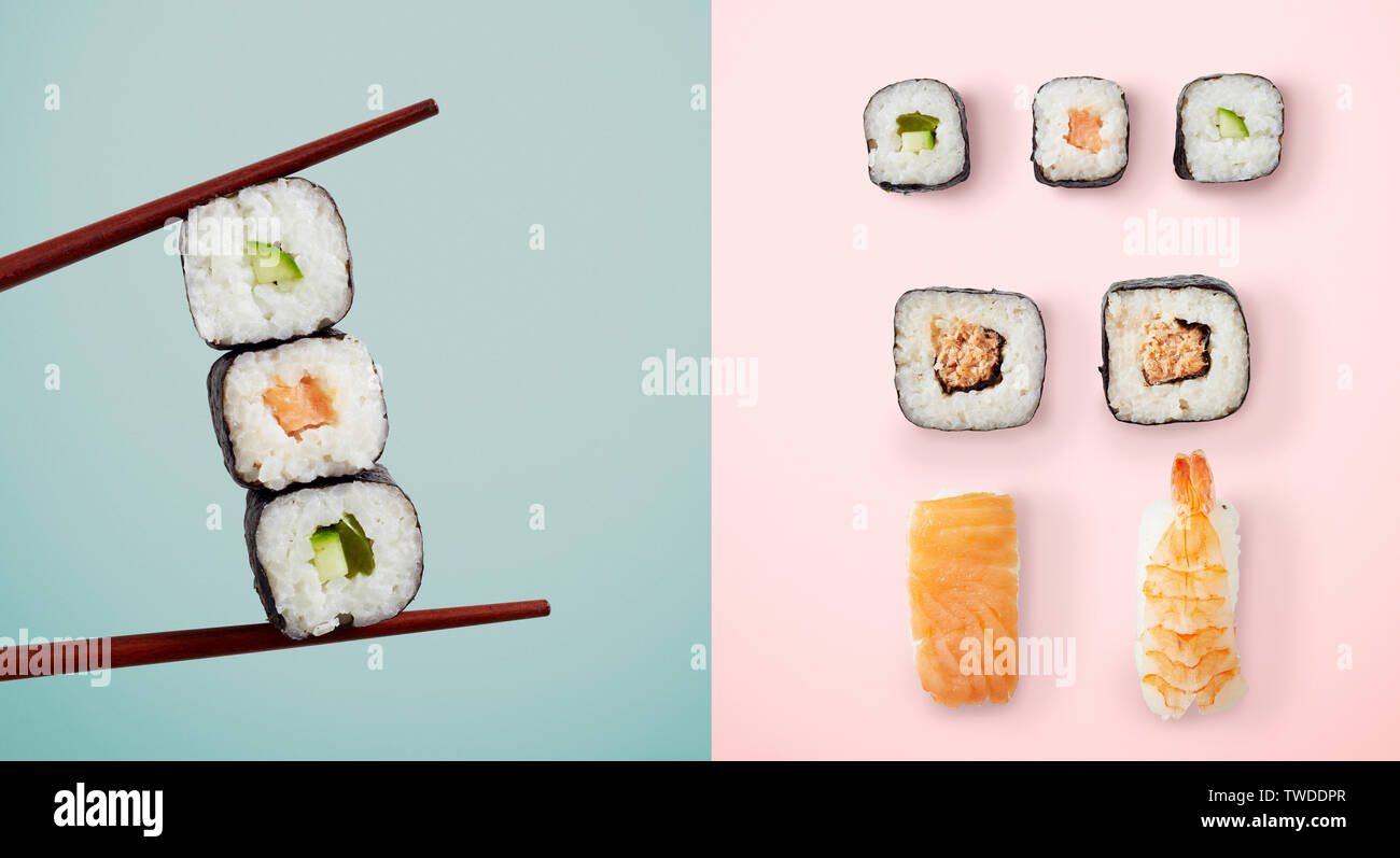 Chopsticks holding seaweed rolls filled with avocado and fish over blue and sushi over pink background - Stock Image