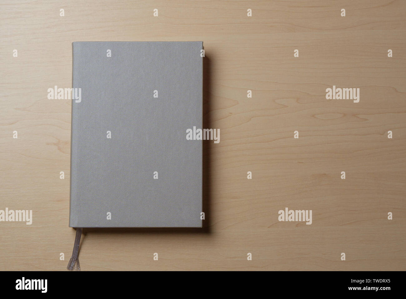 Silver diary on a light table. - Stock Image