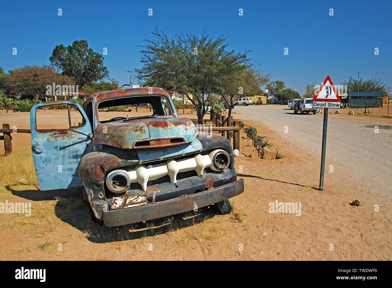 Old truck wreck at the road of the town Solitaire, Namibia, Africa Stock Photo