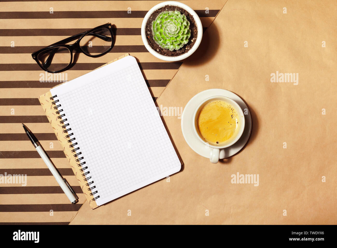 Blank notepad and coffee cup - Stock Image
