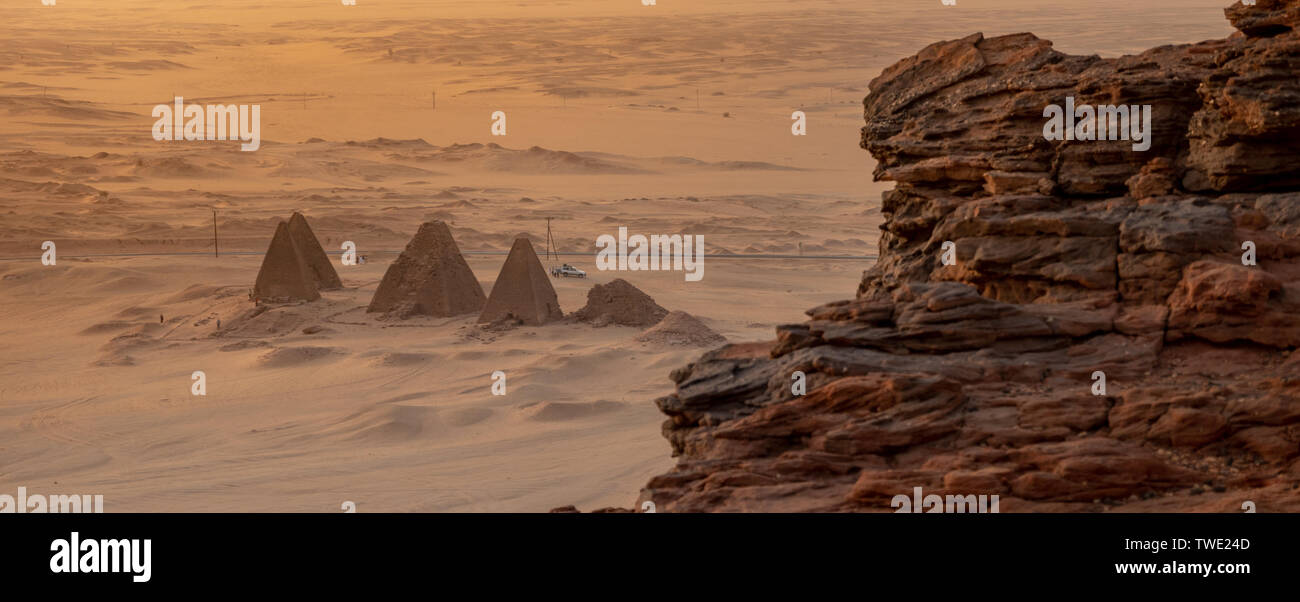 Background with the pyramids of Karima, Sudan, and the corner of the holy mountain Jebal Barkal in the foreground. - Stock Image