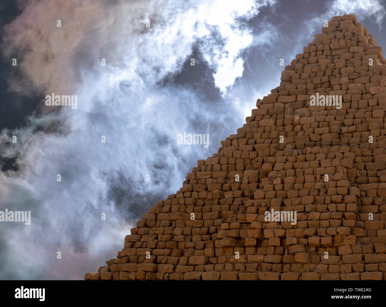 Pyramid of the Black Pharaohs of the Kush Empire in Sudan, with dramatic sky - Stock Image