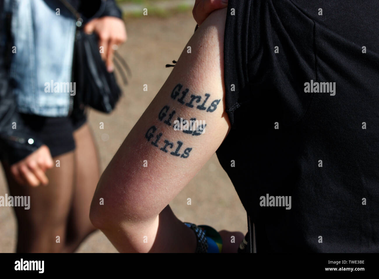 e20468f815927 Tattooed arm of a young female at Helsinki Pride Parade 2015 after-party in  Kaivopuisto