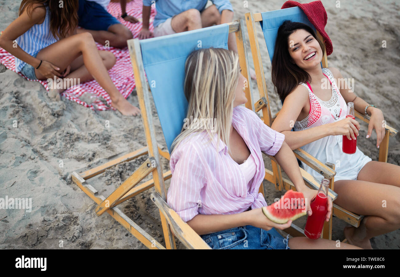 Group of people having great time on the beach at summer party - Stock Image