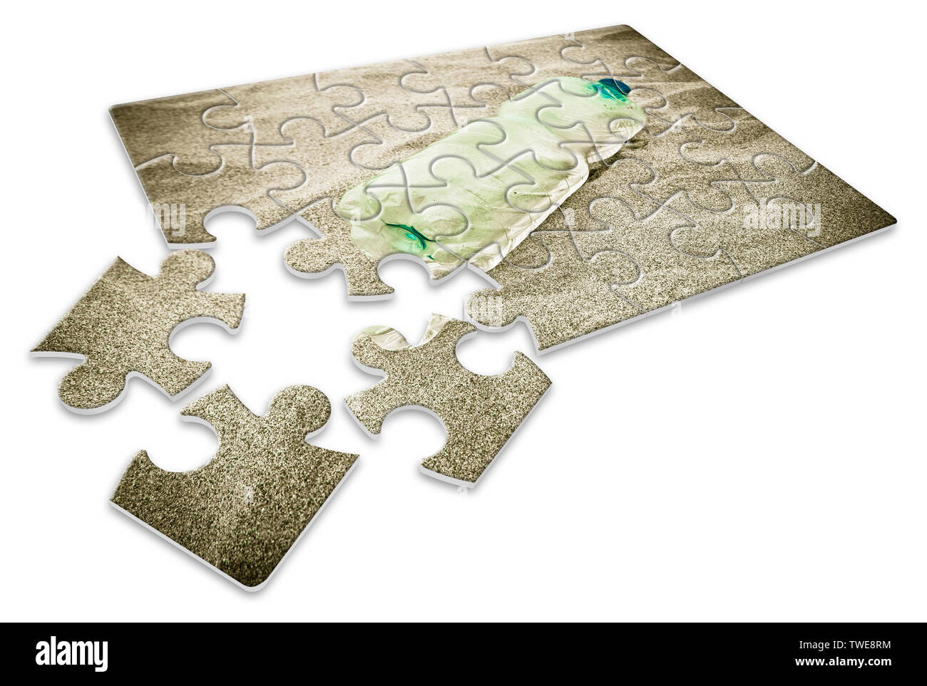 Empty green plastic bottle abandoned on the beach - concept image in jigsaw puzzle shape - Stock Image
