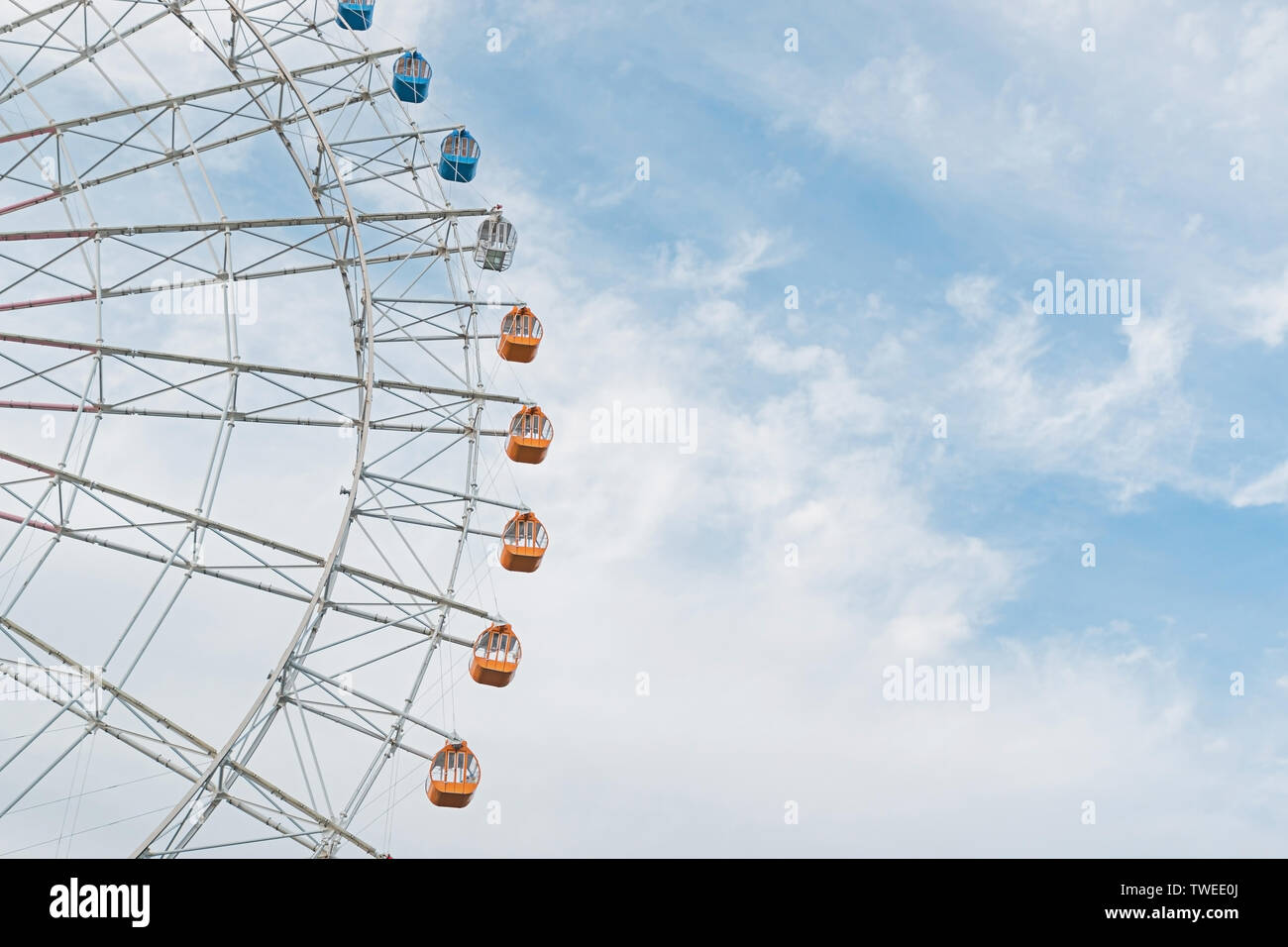 Half of the Ferris wheel against sky. - Stock Image