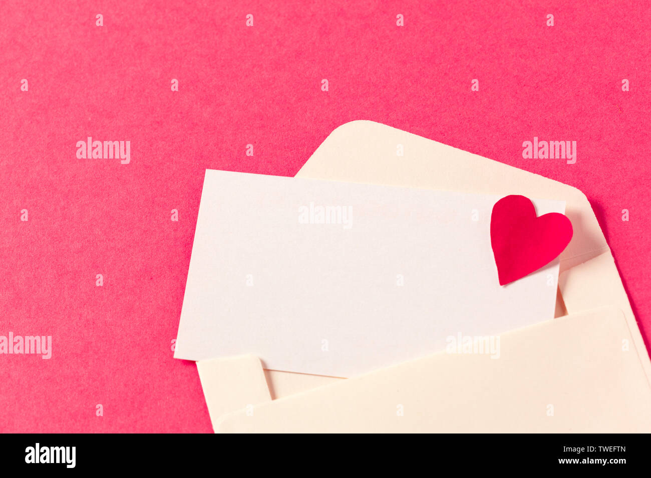 Paper envelopes on a colored pink background - Stock Image