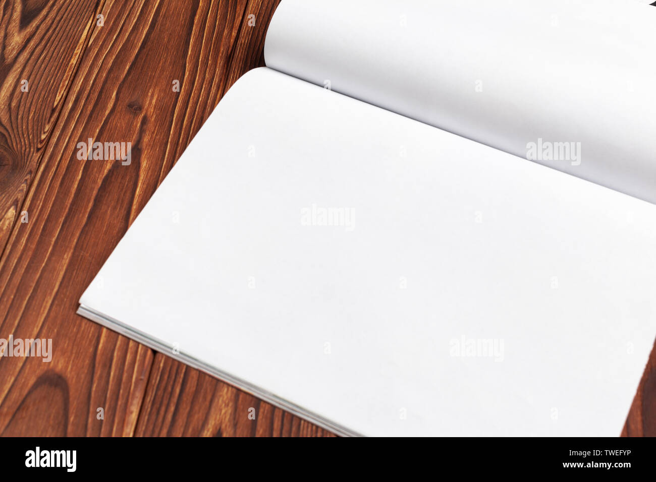 Open blank journal pages for your design copy space on wooden background - Stock Image