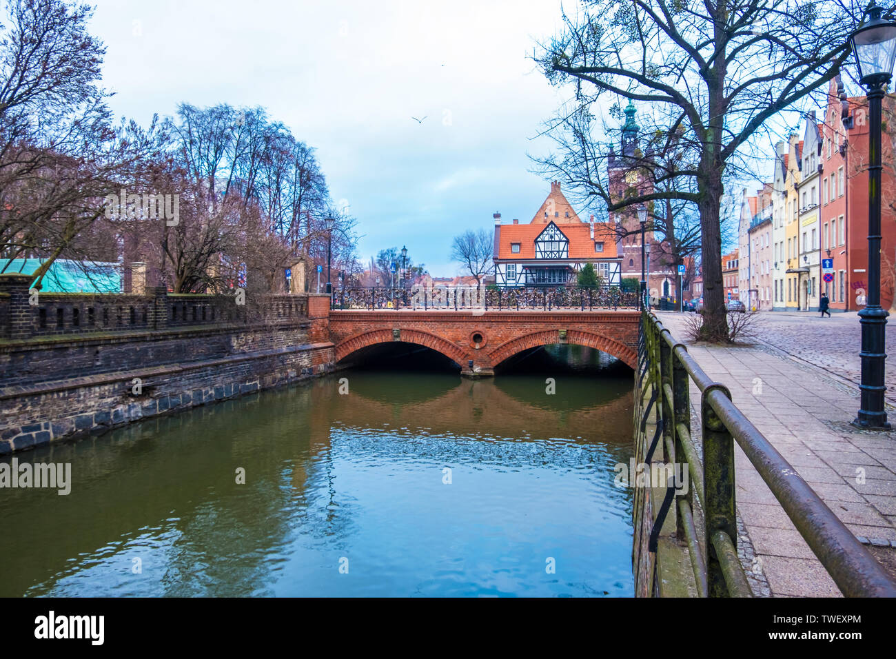 Gdansk, Poland - February 05, 2019: Miller's Guild House and Love Bridge on the canal in Gdansk old town, Poland - Stock Image