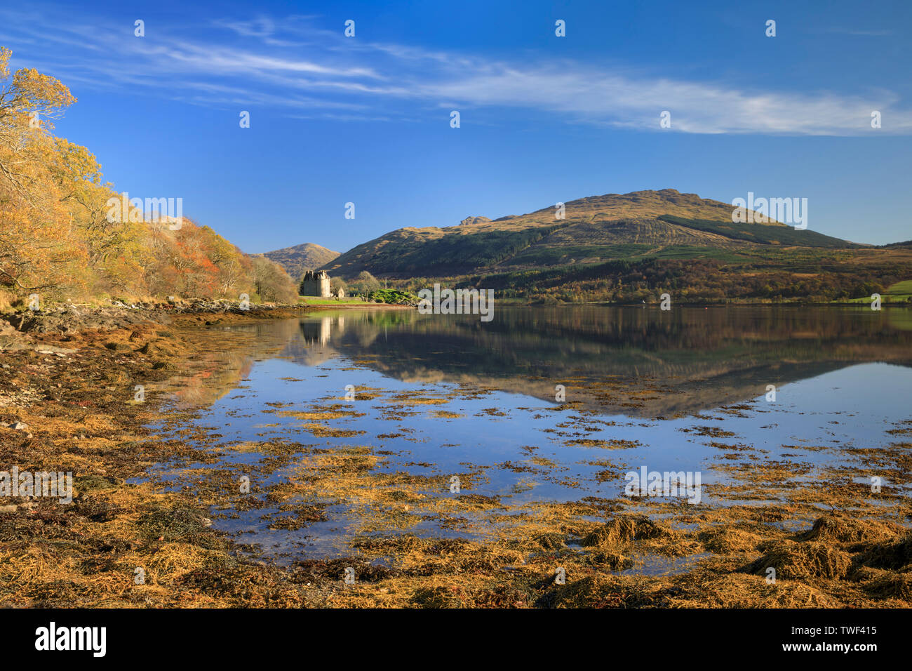 Dunderave Castle reflected in Loch Fyne. - Stock Image