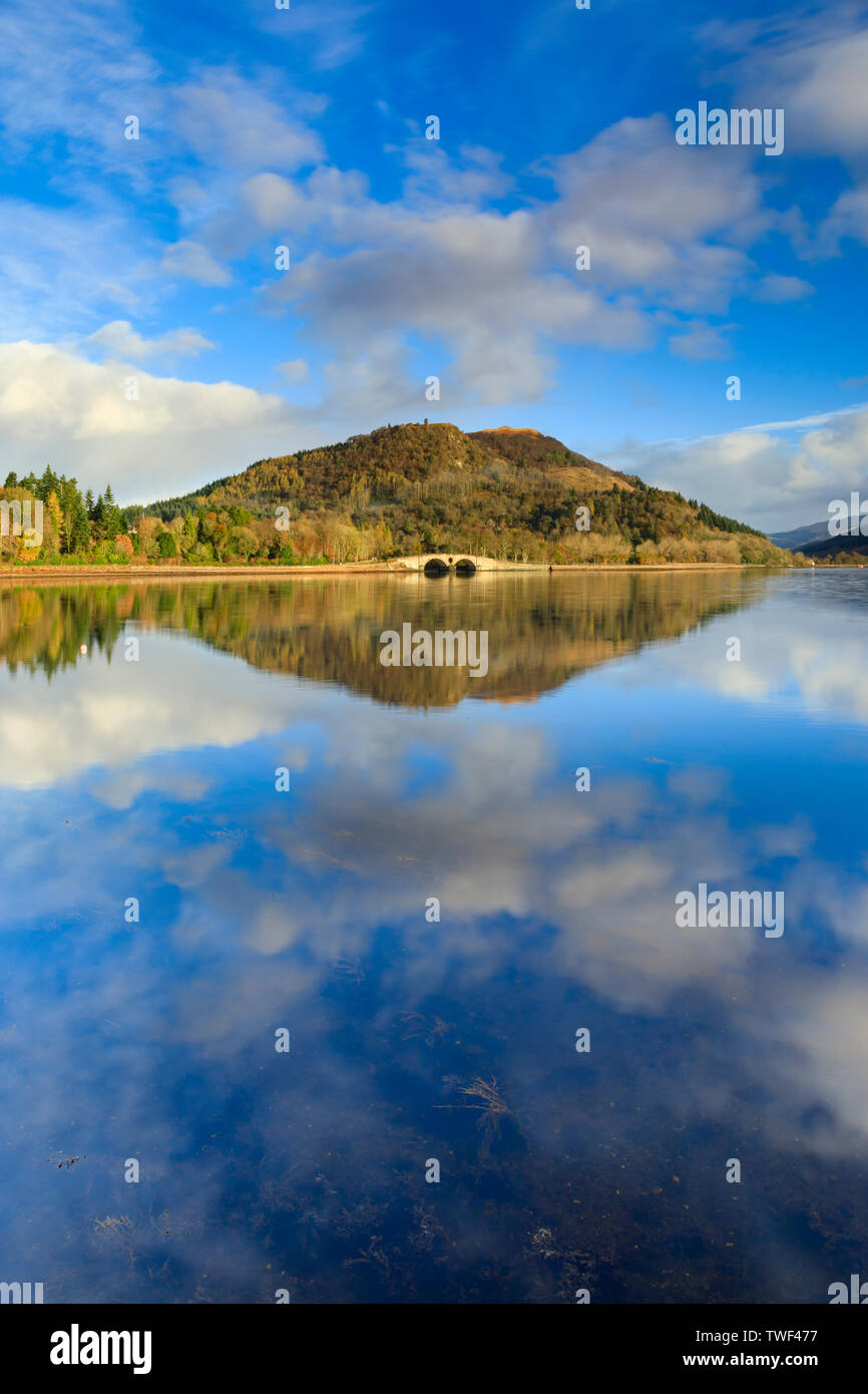 Dun na Cuaiche reflected in Inveraray Harbour. - Stock Image