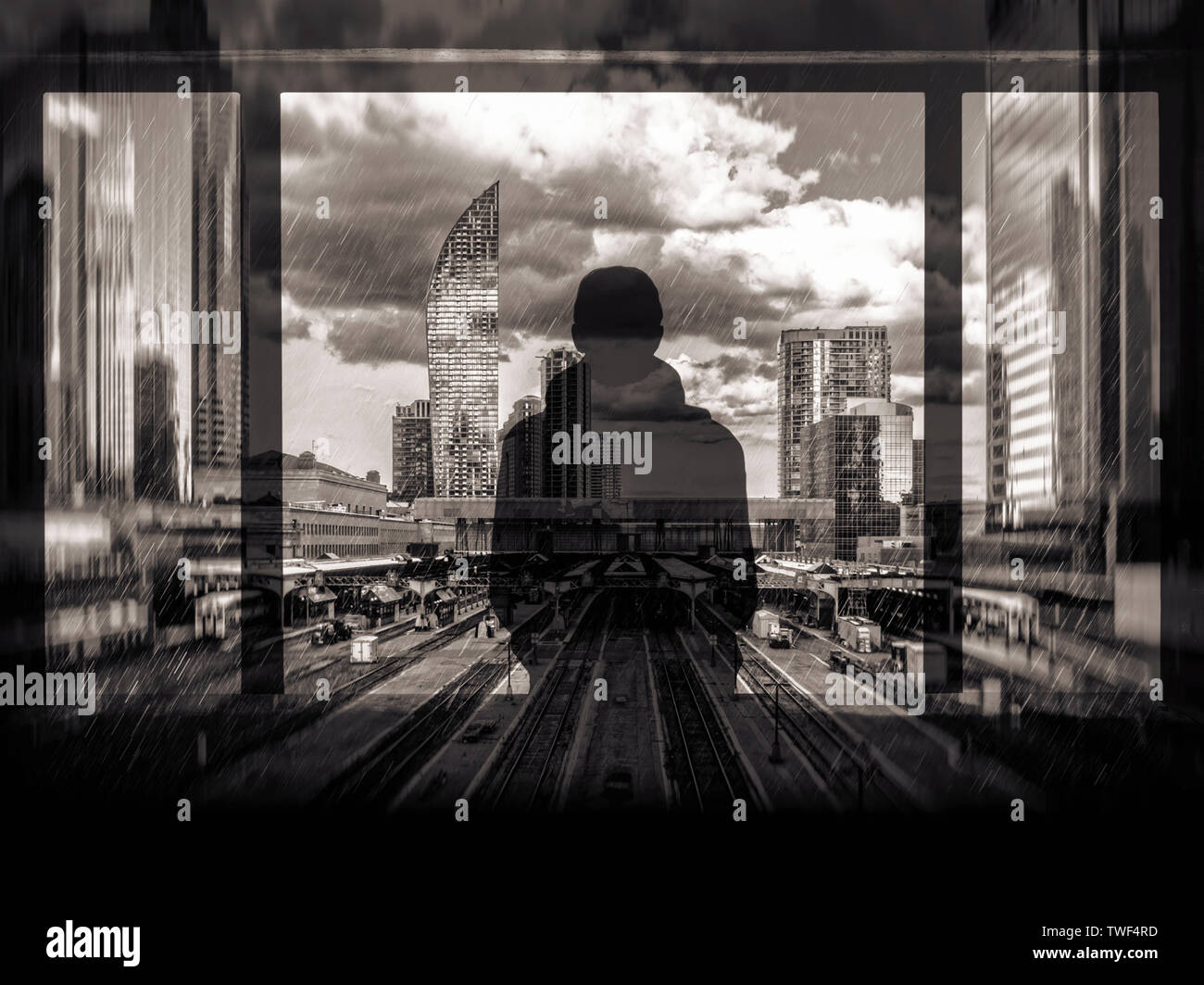 Double-exposure illustration of a person looking out across a railway terminus and city skyline in the rain Stock Photo