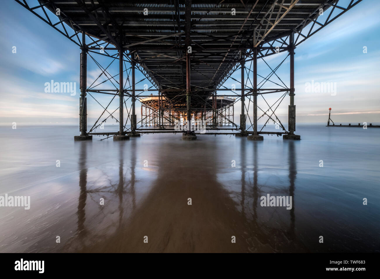 Looking out to see under the pier at Cromer. - Stock Image