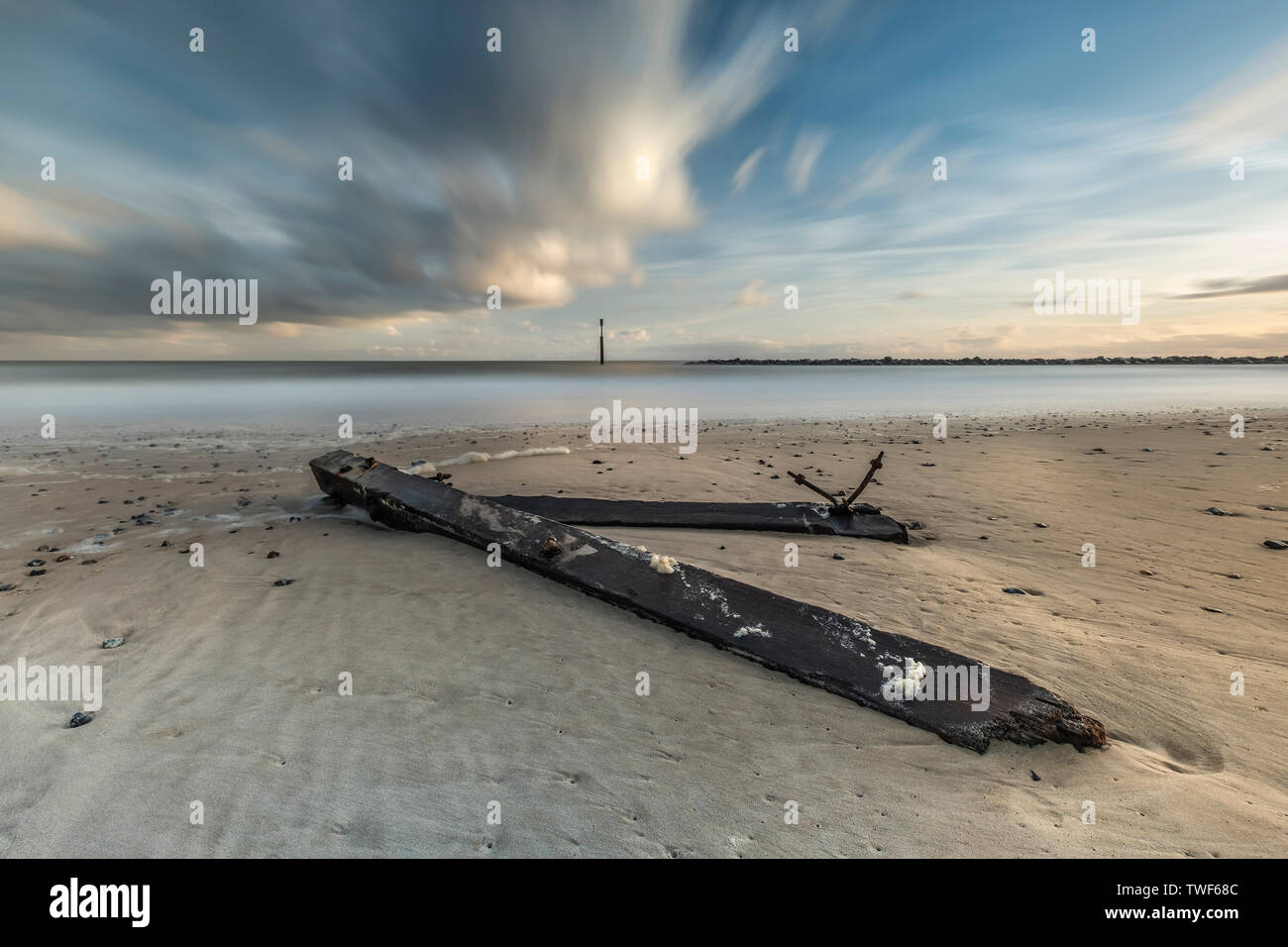Broken sea defences laying on the beach at morning sunrise at Sea Palling in Norfolk. - Stock Image