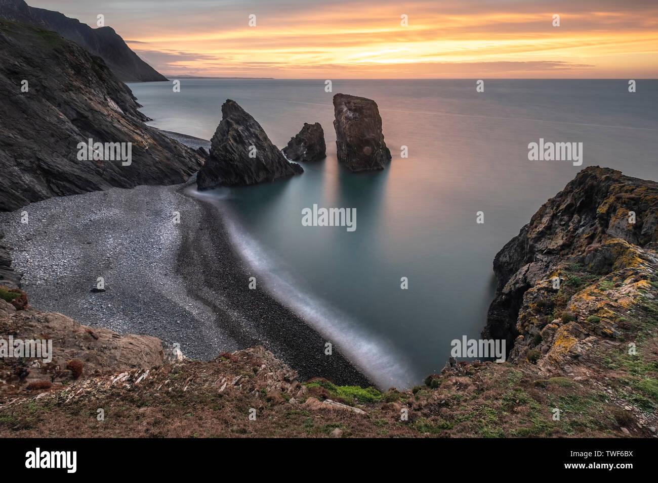 Trefor rock pinnacle at sunset. - Stock Image