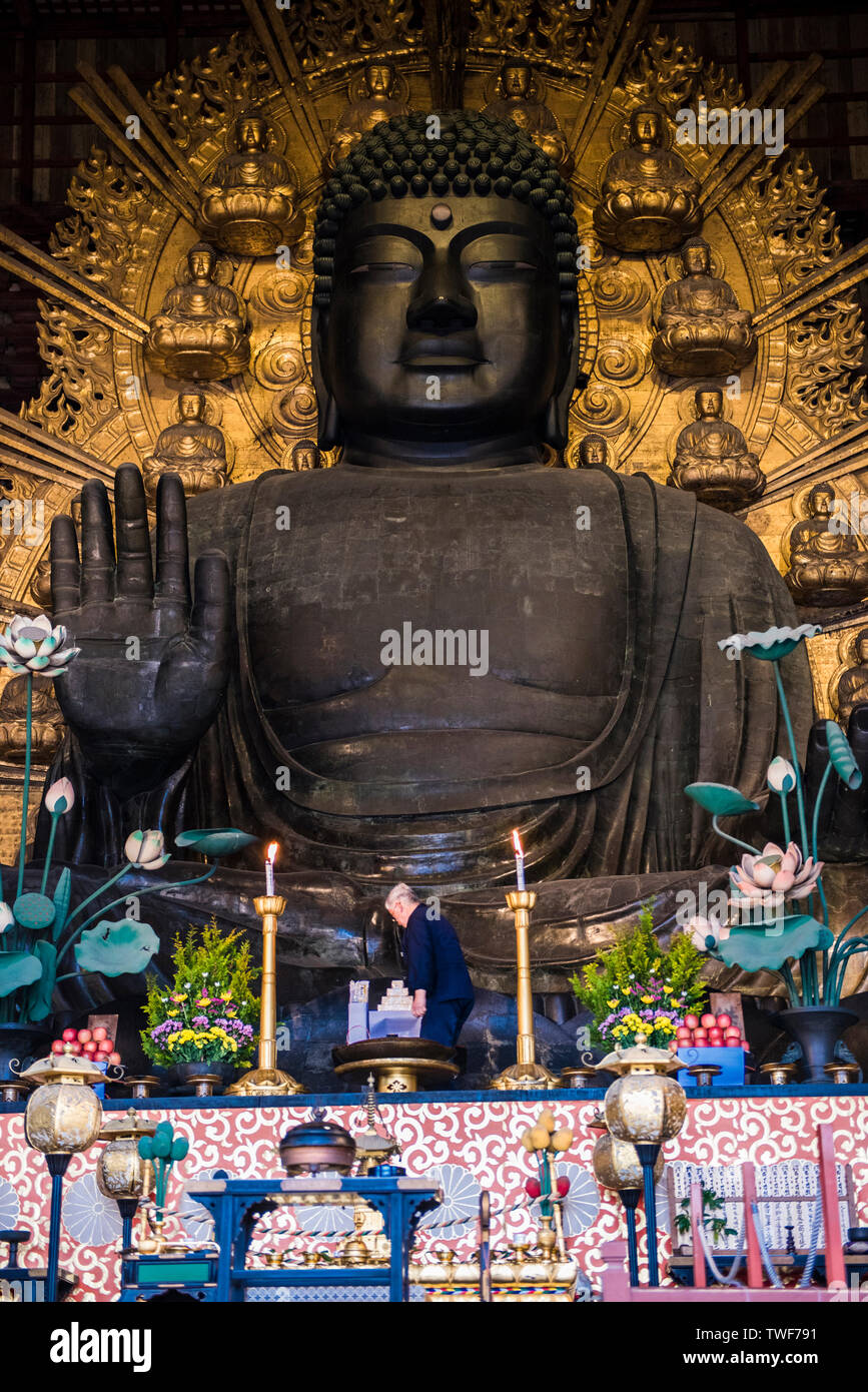 Buddha statute at the Great Buddha hall by the Todai-ji Temple in Nara in Japan. Stock Photo