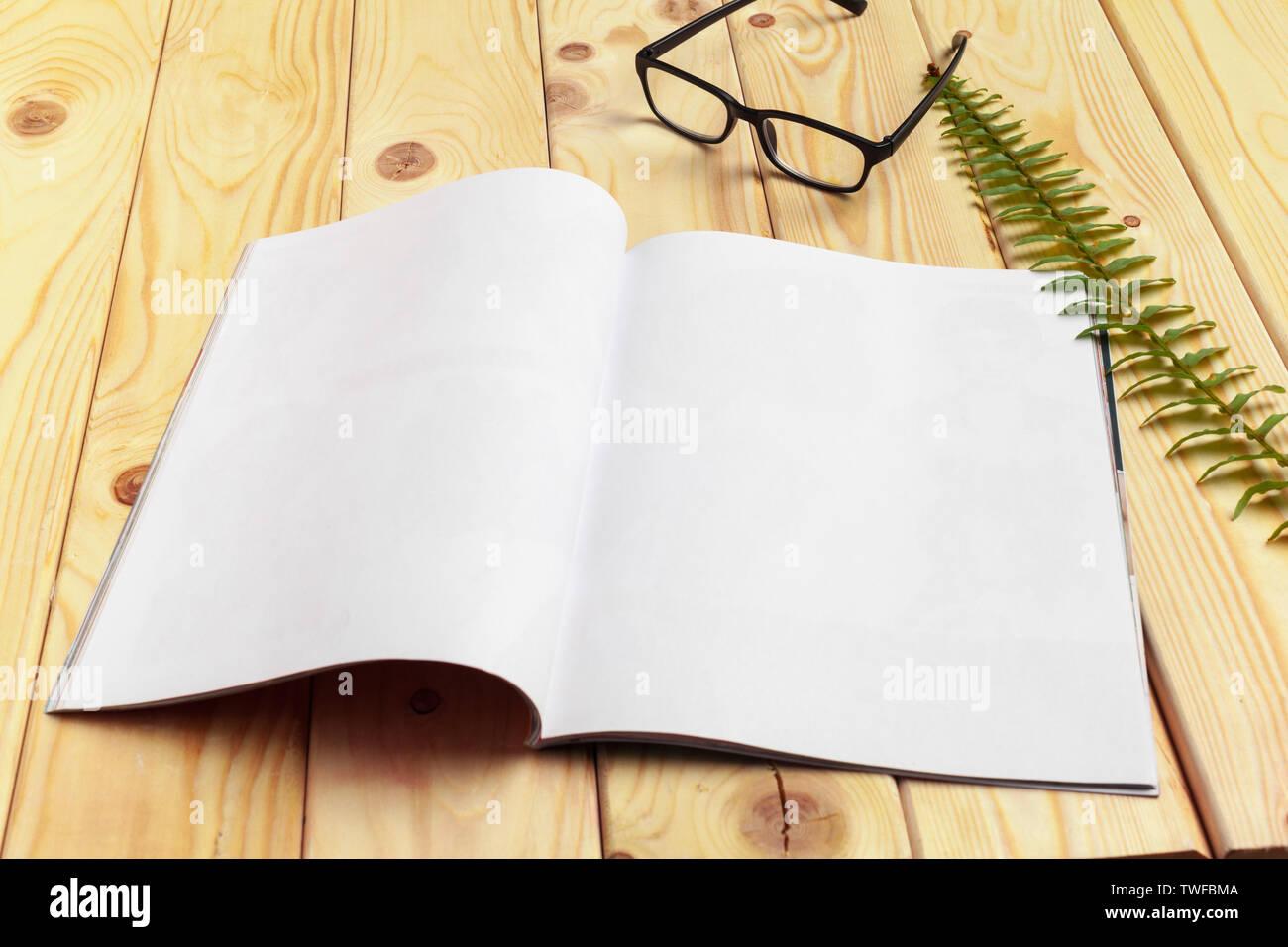 Mock-up magazine or catalog on wooden table. - Stock Image