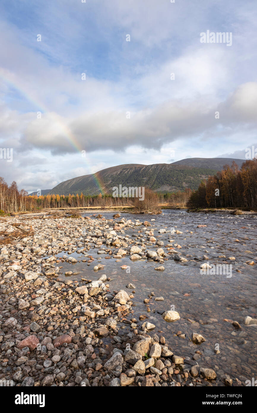 Rainbow over River Feshie in the Cairngorms National Park of Scotland. - Stock Image