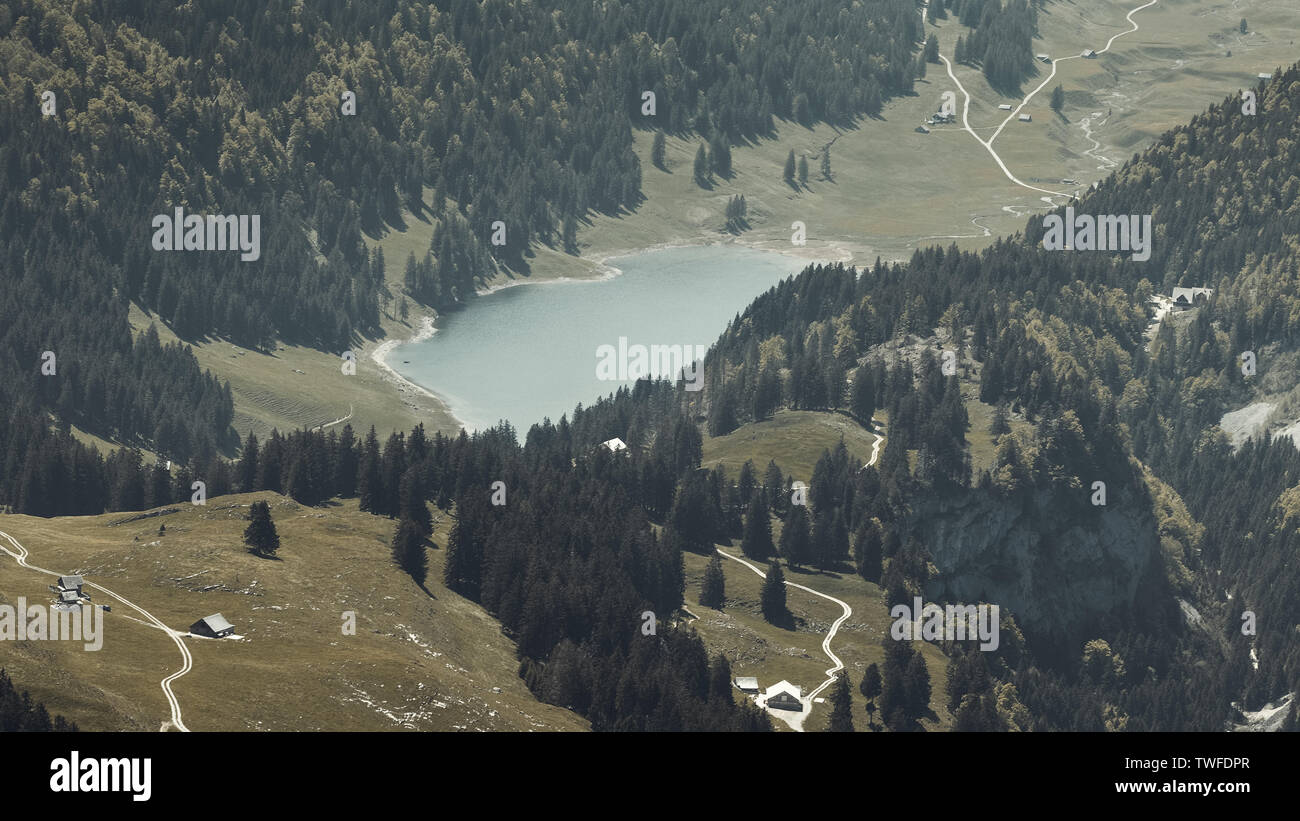 aerial view to the mountain lake Seealpsee at the alpstein massif - Stock Image