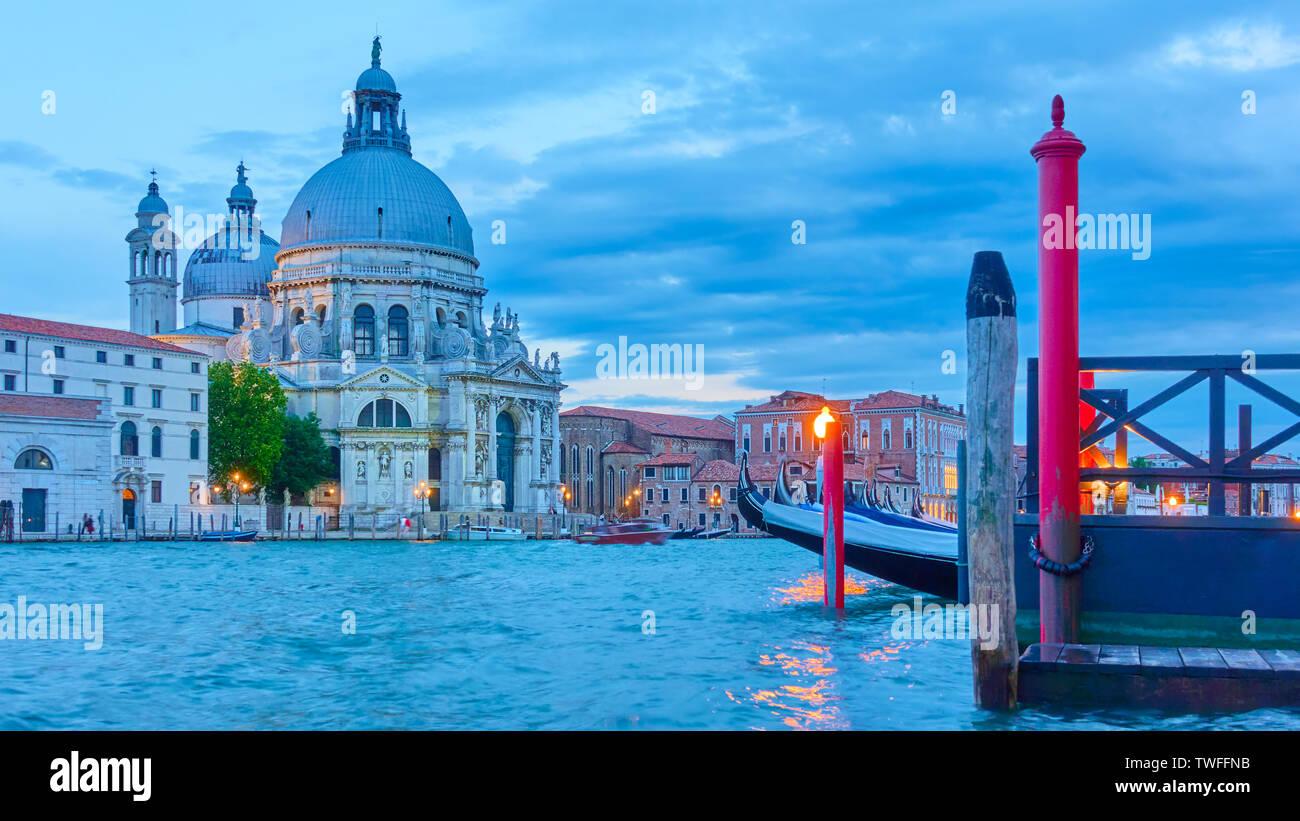 The Grand Canal and Santa Maria della Salute church in Venice at twilight, Italy - Stock Image