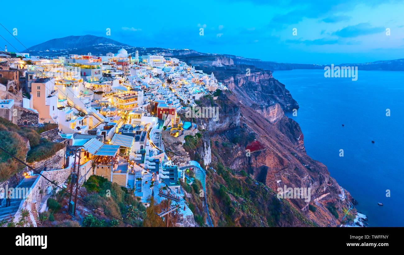 Thira town in Santorini Island at twilight,  Greece. Panoramic view 16:9 - Stock Image