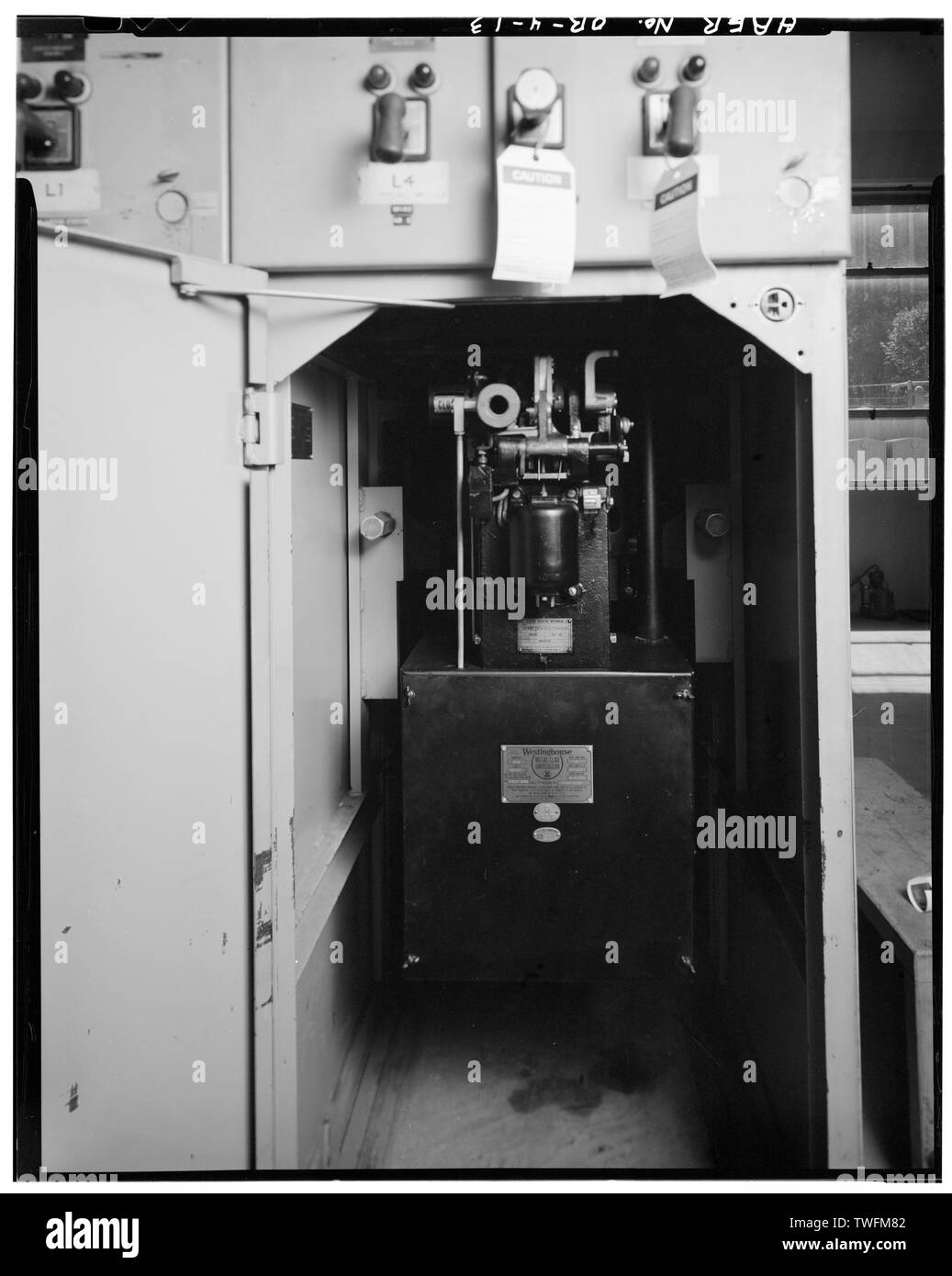 POWER CIRCUIT BREAKER, RECESSED IN CABINET BEHIND HINGED METAL DOOR (SHOWN OPEN), WEST SIDE, MAIN FLOOR - Bonneville Power Administration South Bank Substation, I-84, South of Bonneville Dam Powerhouse, Bonneville, Multnomah County, OR - Stock Image