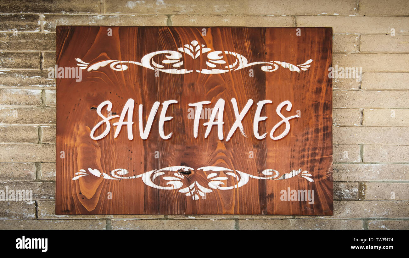 Street Sign the Direction Way to Save Taxes - Stock Image