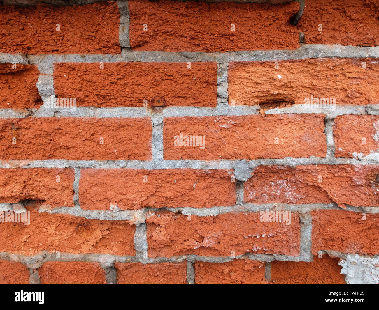 Decaying of erosion red brick wall of 18th century building - Stock Image