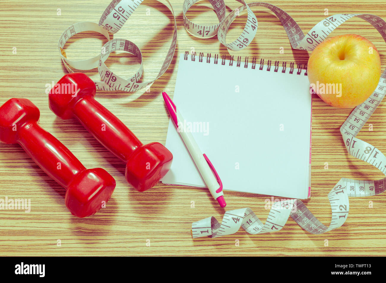 Workout plan and sports equipment - Stock Image