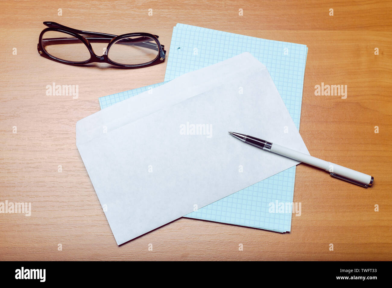 Photo of blank envelope on a  wooden background - Stock Image