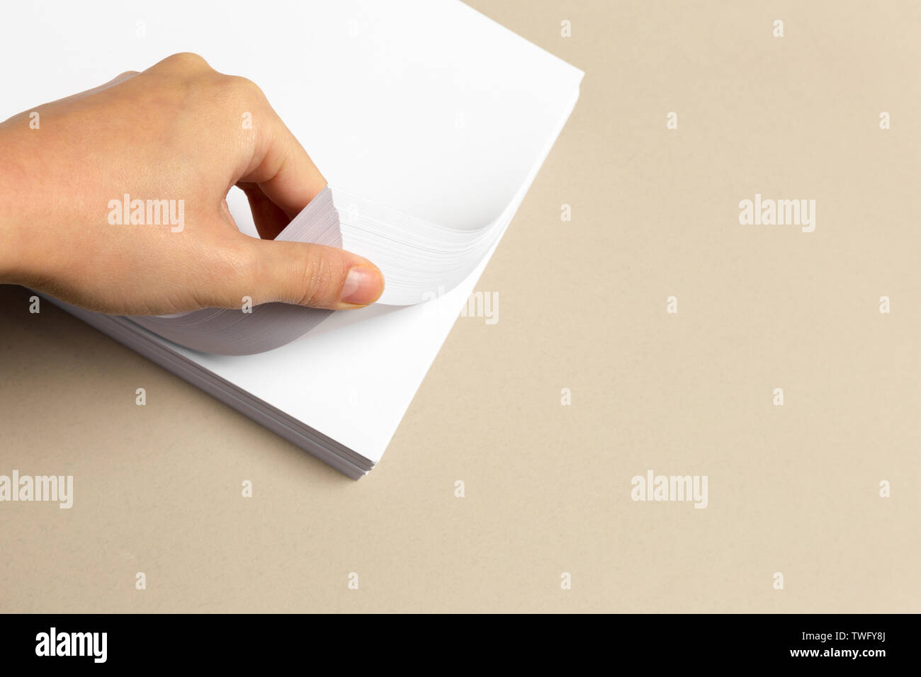 Blank paper on wood table - Stock Image