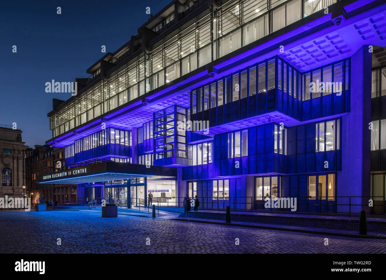 Queen Elizabeth 11 Centre, Westminster, London, United Kingdom at twilight, with artifical lighting - Stock Image