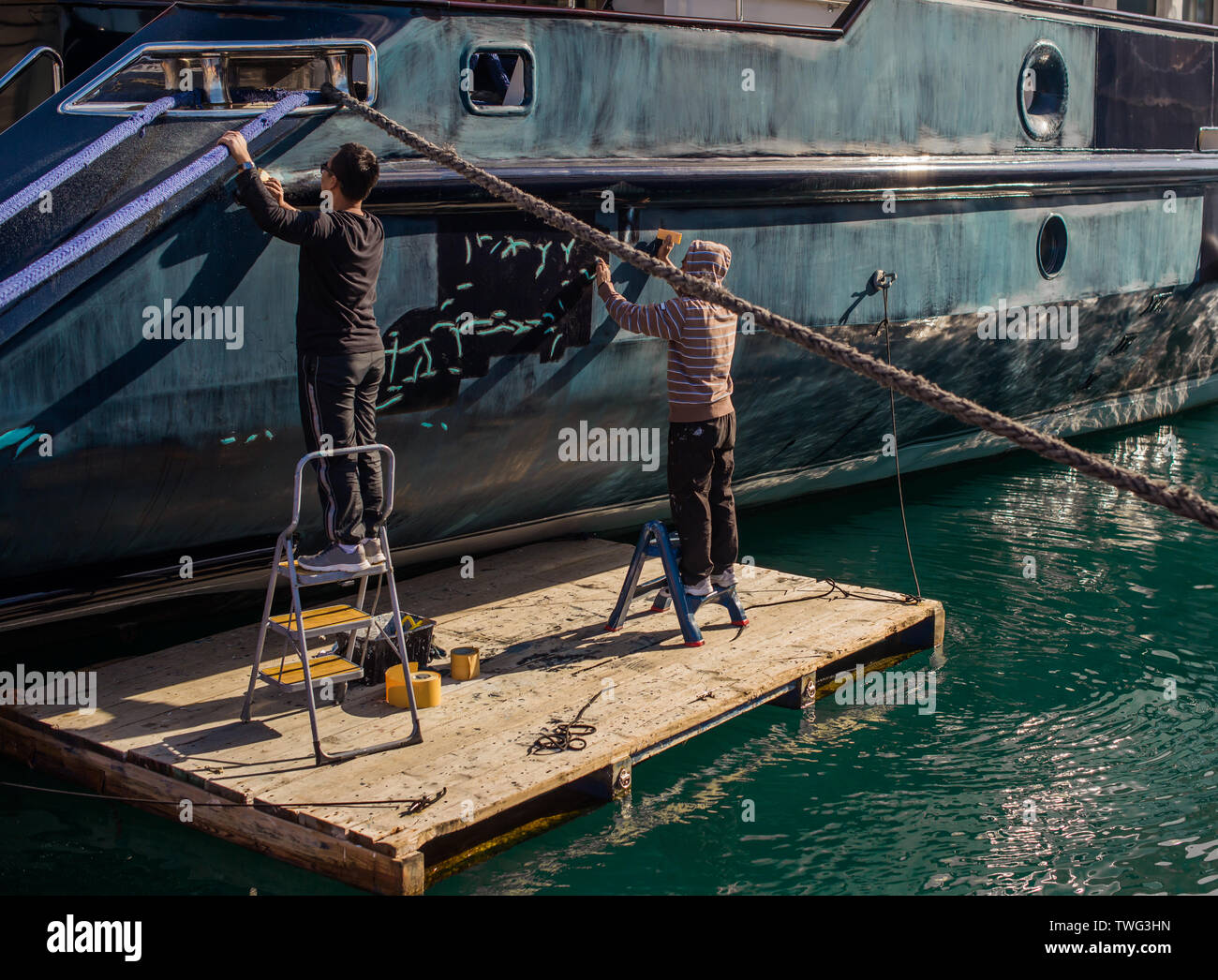 Preparation of the boat for painting. - Stock Image