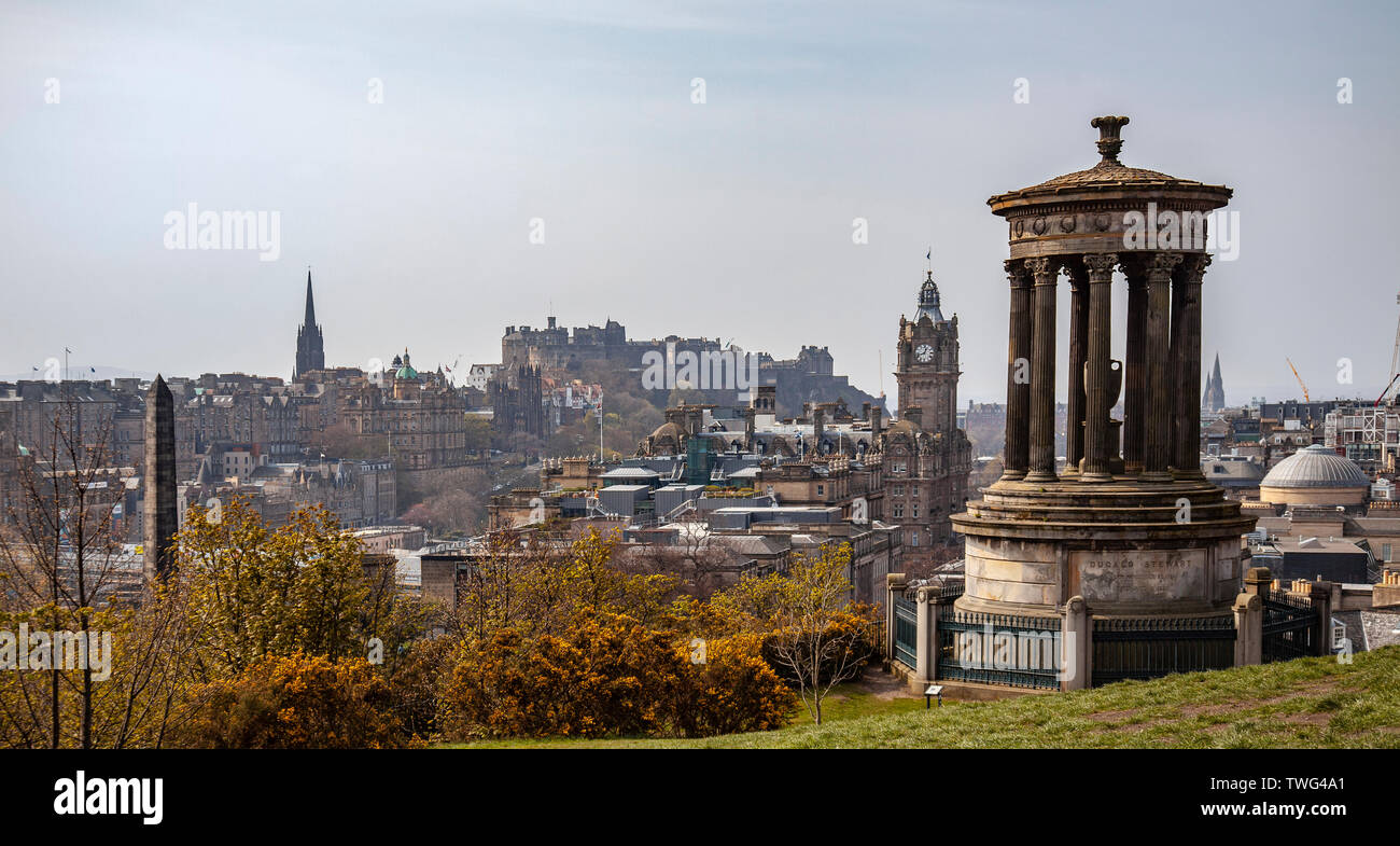 Elevated view of part of Edinburgh city centre featuring the Dugald Stewart monument, the Balmoral Hotel, Edinburgh Castle, New College, Scotland. Stock Photo