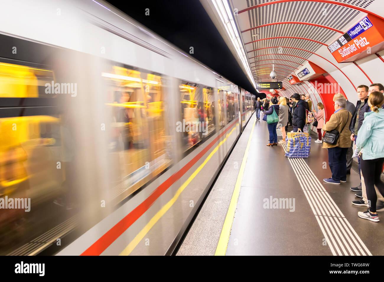 Vienna, Austria - May 23, 2019: Train arriving to platform on the underground in Vienna. Vienna public transport, Wiener Linien, operates five undergr - Stock Image