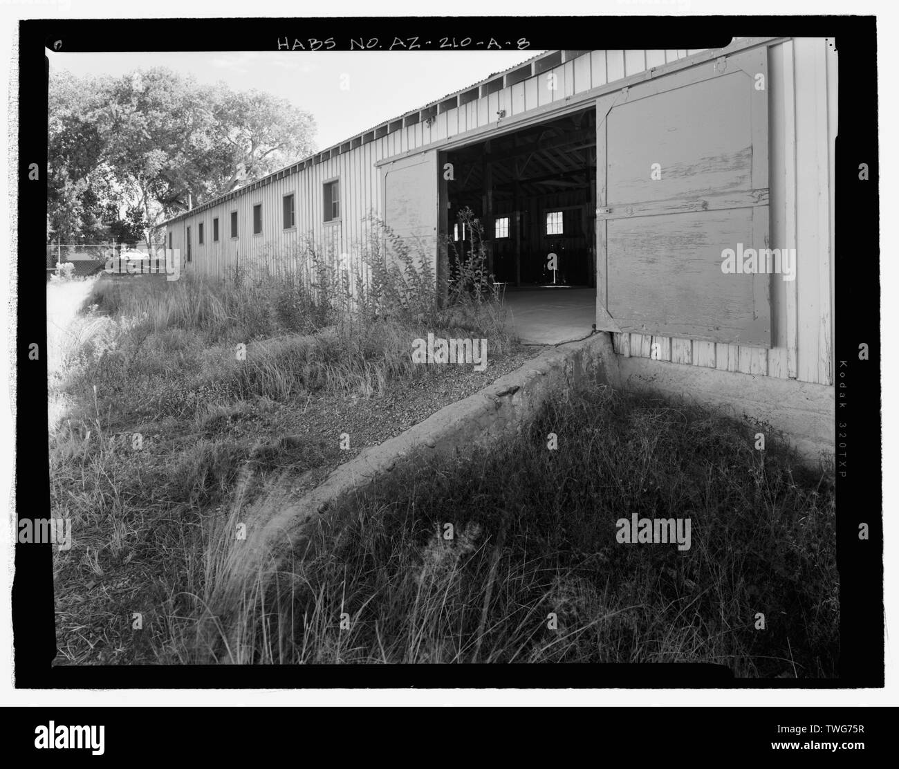 RAMP AND SLIDING DOOR ON NORTH SIDE, FROM NORTHWEST - Fort Huachuca, Cavalry Stable, Clarkson Road, Sierra Vista, Cochise County, AZ - Stock Image
