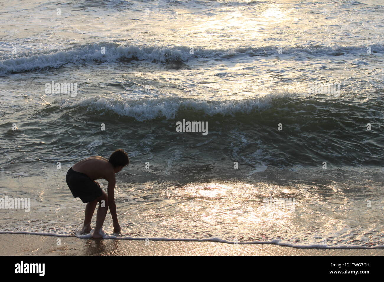 Young boy playing in the sea in Sri Lanka - Stock Image