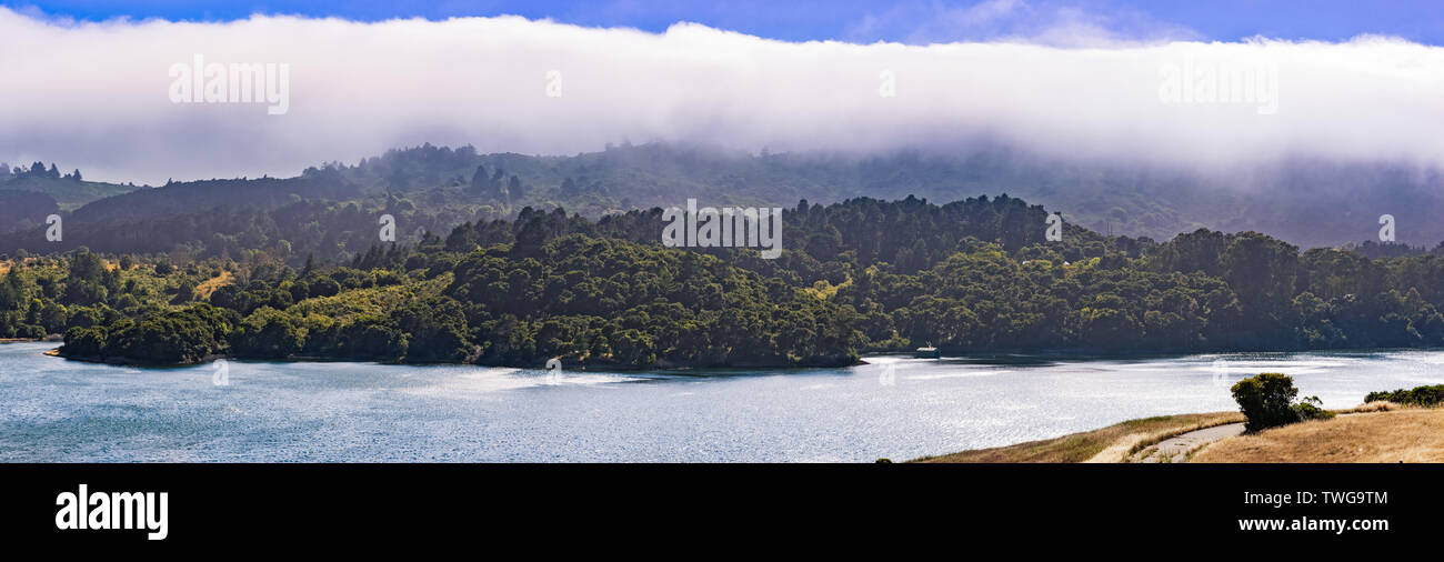 Upper Crystal Springs Reservoir,  part of the San Mateo Creek watershed and Santa Cruz mountains covered with clouds visible in the background; San Ma - Stock Image