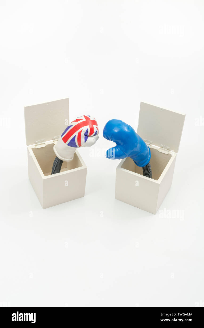 Mini UK & Blue EU boxing gloves in Jack in a Box concept. Metaphor   UK-EU relations, UK Brexit negotiations, UK Brussels relationship, trading blows - Stock Image