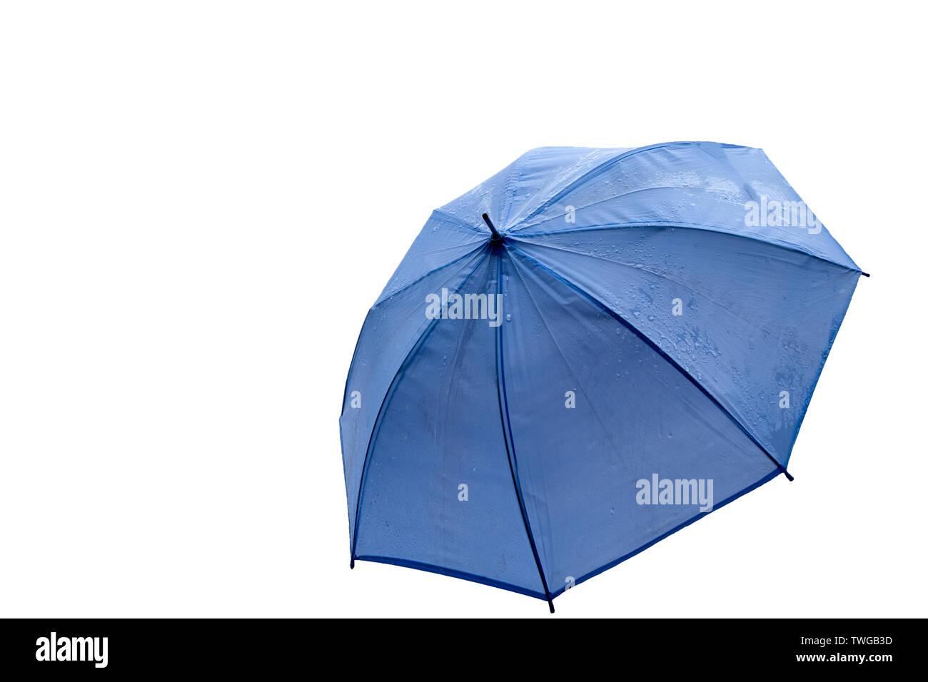 Blue Umbrella opening wet rainy. isolated on white background - Stock Image