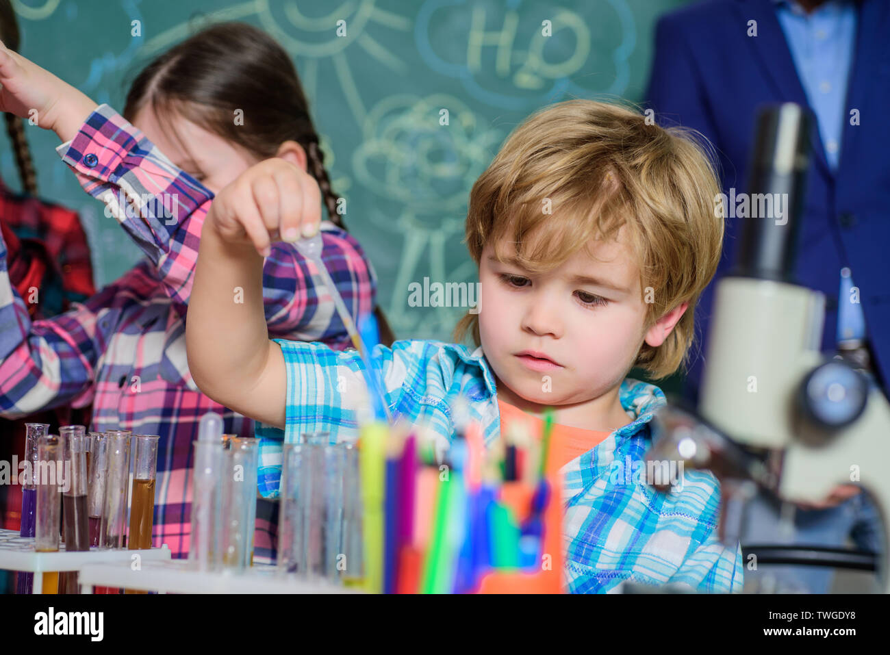 back to school. Educational concept. children scientists making experiments in laboratory. Pupils in chemistry class. School chemistry laboratory. happy children teacher. modern school workplace - Stock Image