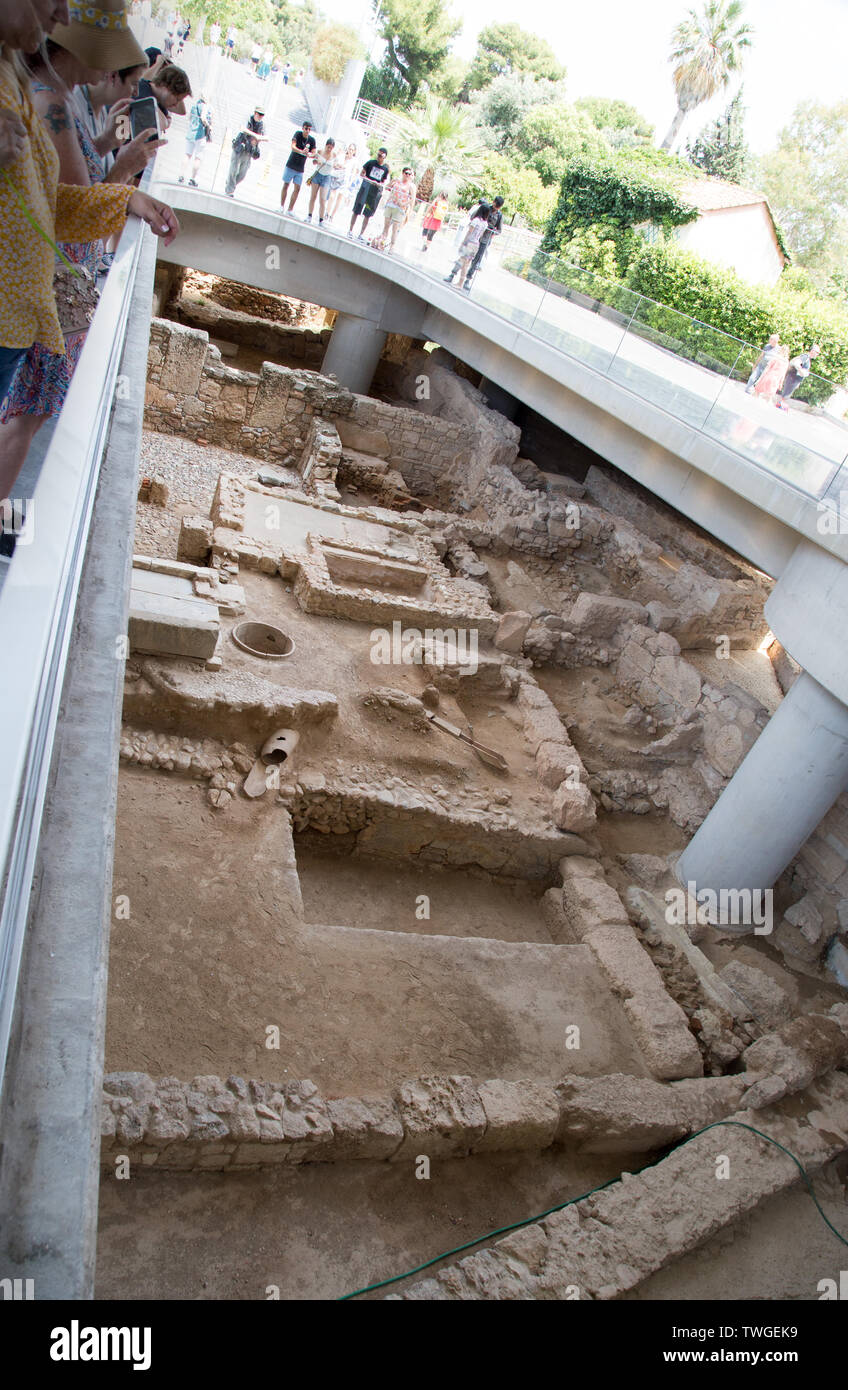 The newest exhibit at the New Acropolis Museum in Athens Greece is the excavated ancient town underneath the museum Stock Photo