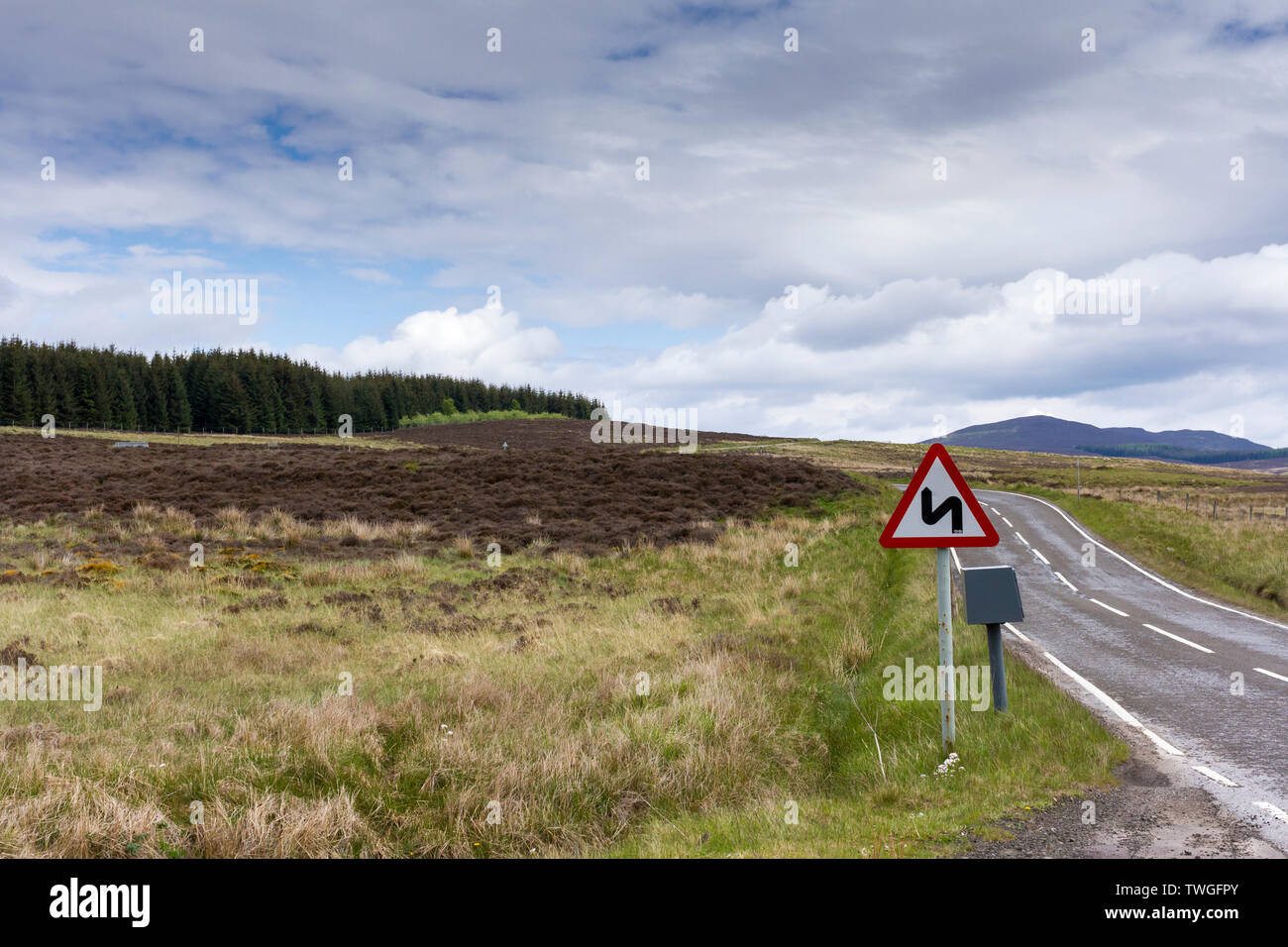 Double bend red triangle warning sign on the A924 road in Perthshire, Scotland, UK - Stock Image